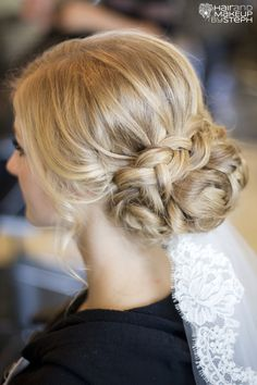 Braided Bun Beauty ... Nicole Seiley, I found your wedding hair style!