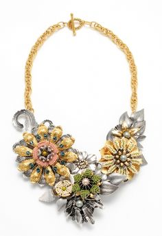 Elaborately beaded filigree flowers used in a vintage Haskell necklace. From MiriamHaskell.com.