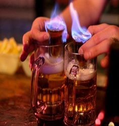 Flaming Dr.Peppers - Amaretto shots topped with 151 Rum, set alight and dropped into beer