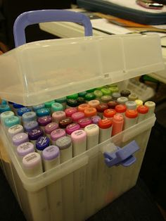 My Acrylix Organizers can hold anything. Here it's holding 120 Copic Markers using a grid system from plastic needlepoint canvas! Cool.