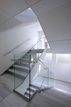 It is as simple as white, glass, metal and floating staircases.