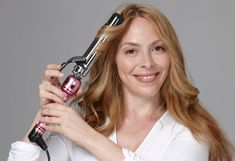 Starting around the face, use a 1¼-inch curling iron to create waves in two-inch sections. Twirl the hair away from the face, and keep the iron at a 45-degree angle.