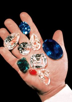 Harry Winston holding the 337.10-carat oval-shaped Catherine the Great sapphire amongst other exceptional gems. In the name of security (he had a habit of keeping large stones in his pocket), Winston never allowed his face to be photographed.