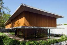 long-glass-house-with-folding-wooden-facade-8-rear.jpg
