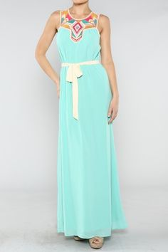 I am in love with this dress! Love the color (it's perfect for spring/summer), and I love the pattern on the neckline!