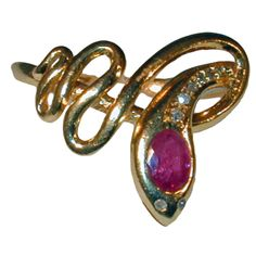 Antique Ruby and Diamond Snake Ring | From a unique collection of vintage fashion rings at https://www.1stdibs.com/jewelry/rings/fashion-rings/