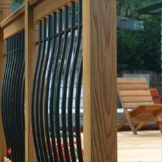 BuildDirect – Tuscany Series Wood Railing Kits – Pine - Curved Black Baluster - Outdoor View