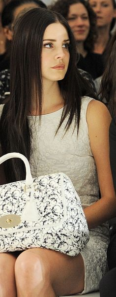 Lana looks AMAZING, with dark hair...
