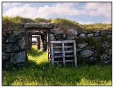 Blackhouse on Isle of Lewis - this is the finished wall height and a roof of turf or thatch would finish it. The attached cattle byre is seen through the far door. These were lived in until the 1960s and will be lived in again in my novel!