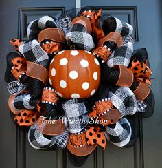 "Celebrate a not-so-spooky Halloween with this cute Polka Dot Pumpkin Halloween Wreath! It is done on black mesh with orange mesh ribbon, black and white paper mesh, and assorted ribbon accents. It is topped off with half of an orange craft pumpkin painted with large white polka dots. This wreath measures about 26"" across and is made to order."