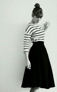 Stripe top and black flared skirt with high bun