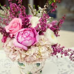 """Pink Teapot Centerpieces  """"Their florist used teapots for the reception centerpieces, which guests were encouraged to take home at the end of the night."""""""