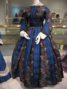 2012-08-25 KSMF -  Blue and black silk taffeta dress with golden warp printed leaves, circa 1860.