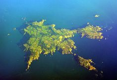 Isle of Sark, Channel Islands, UK  - In the pictures that I've seen of this dark sky community, there's a lot of hiking and stuff to do during the day.  I would totally go camping here, too.