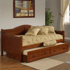 Gorgeous Wooden Daybed With Trundle And Many Cushions