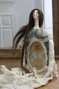 Litha - art doll sculpture made with a vintage book, dried flowers in glass frame, cloth and clay - by Pantovola