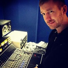 Calvin Harris fooling around in the studio. He looks like he is up to something, hoping it is more musical genius.