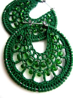 Hand made crocheted hoops. The interior panel is knitted with a very light green thread and matching colour beads within the web.  They are