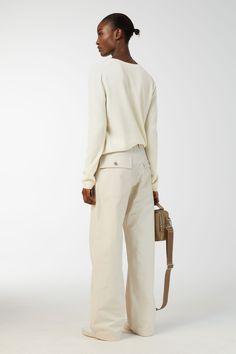Model side image of Arket cotton twill workwear trousers in beige