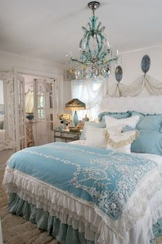 Yummy! Pure romance. Bedspread with lace appliques, tons of ruffles, a mound of cushions, and a delightful aqua and clear crystal chandelier are some of the highlights of this Shabby Cottage Chic bedroom (via shabby cottage,)