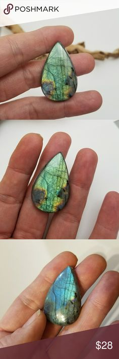 Labradorite Cabochon ▪Labradorite Gemstone▪ •Cabochon - Flat Back - Rounded Top •Natural - Genuine - No Treatment •Pear Shape  •38mm x 22mm •This Labradorite has an amazing amount of flash in a wide range of colors. From blue, green, yellow, red and a hint of purple at just the right angle near the bottom right side. •Great for wire wrapping and jewelry making.  •These pictures have not been altered or photoshoped in any way except to crop them for posting.  •I sell my cabochon by size, not…