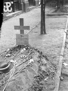 Grave of a fallen Polish soldier on Bouden Street, in the Warsaws city centre, Poland. Warsaw Uprising, 19th August 1944