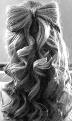 Hair bow with curls.