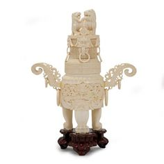 Chinese Carved Ivory Covered Footed Vessel   Of circular form, decorated with lion masks and ring handles, dragons and foo lions, on a carved hardwood stand. Height 18 3/4 inches.     Estate of a Washington, D.C. Philanthropist