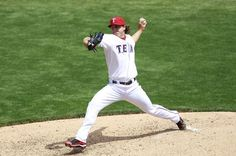 ARLINGTON, TX - APRIL 12:  Derek Holland #45 of the Texas Rangers delivers a pitch against the Seattle Mariners at Rangers Ballpark in Arlington on April 12, 2012 in Arlington, Texas. (Photo by Rick Yeatts/Getty Images) game 7