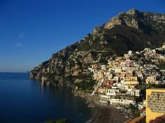 Positano is a small picturesque town with splendid coastal views, on the famous Amalfi Coast in Campania, Italy. The town itself is perched on an enclave on the face of a hill and winds down towards the waters of the Amalfi Coast. Naturally beautiful, Positano attracts thousands of visitors every year. All year long, the town is always full of people, but if you are planning to visit Positano, it would be best to schedule your trip during the spring season.