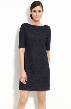 An elbow-sleeve shift with a bateau neckline is fashioned with circular lace layered over tonal lining.