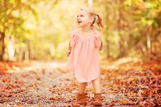 child dances in saturated autumn light
