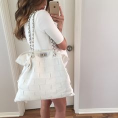 """White Chanel Quilted Leather Handbag 100% authentic Chanel Quilted Handbag. Purchased from Neiman Marcus, Ca. Includes: Dust bag, NM tags, Chanel booklets and authenticity card. Hardware is silver, gently used in great condition, corners have tiny scuffs on them from setting the bag down, no stains on the inside/outside of bag. Inside is perfect and still has plastic on the zipper pull. Kept in a smoke free home. This bag is GORGEOUS in person. 16.5"""" tall • 18"""" wide with drawstring pulls to…"""
