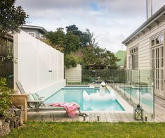 Remuera villa with pool, love the swan swimming in the pool