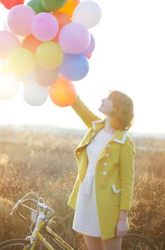 balloons and a yellow coat