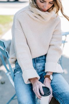 Jess Ann Kirby's fall outfits wearing a Free People Sweater