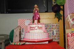 barbie topped birthday cake