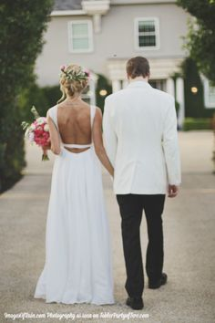 """The beautiful couple right after saying """"I do!!!"""" Love the white dinner jacket!"""