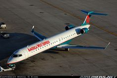America West Express Bombardier bathing in morning sunlight at Phoenix-Sky Harbor, January (Photo: Royal S King) America West Airlines, Jet Airlines, Us Airways, Come Fly With Me, Commercial Aircraft, Aircraft Pictures, Morning Light, Airplane, Planes