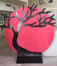 Magalie Sarnataro's props. Asian cherry tree sunset in the making 7x7 :foam board cutout, black paint, sunset 6,5x6,5 foam board circle, covered with round red plastic table cloth Cherry blossom led lights will be added  Asian themed party