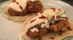 Fish taco sauce made with sour cream, lime juice, and sriracha hot sauce is a spicy addition to your favorite fish.