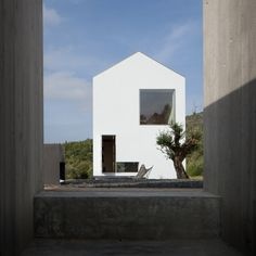 João Mendes Ribeiro slots concrete wine cellar below gabled house in rural Portugal. Photography is by José Campos.