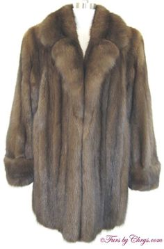 Russian Sable Jacket RS761; $5999 (final reduction!); Excellent Condition; Size estimate: Misses 8 - 12. This is a luxurious genuine natural Royal Crown Russian sable fur jacket in the versatile stroller length, which looks as if it has never been worn.  It has beautiful silvery tips which is one indication of high quality sable. Your purchase will be accompanied by a copy of an appraisal showing the value to be $70,000. Yudofsky Furriers and Crown Russian Sable labels. fursbychrys.com