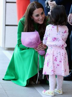 Catherine, Duchess of Cambridge meets a young girl as she arrives at the Portrait Gallery on April 24, 2014 in Canberra, Australia.
