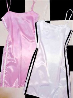 We heard you need a dress that will make a guy cum in his pants as soon as he see you? Ok, we got cha.  This silk kitten dress features double stripes at side. Satin blend Adjustable straps No stretch Side zipper closure