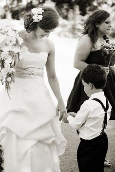 So precious- ring bearer checking out the ring!