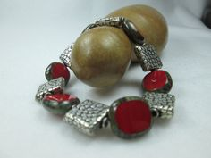 THIS SIMPLE, MINIMALIST, METAL AND GLASS BEADED, STRETCH BRACELET WOULD GO PERFECTLY WITH YOUR BUSINESS WARDROBE!  UNIQUE, CHUNKY AND BOLD, THIS DESIGNER BRACELET IS HANDMA...