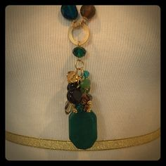 """Emerald and Blue long necklace Emerald green, brown, gold and blue stone long necklace. Adjustable from 28.5""""-31"""" long. Perfect condition and worn only once Pretty Please Fashions Jewelry Necklaces"""