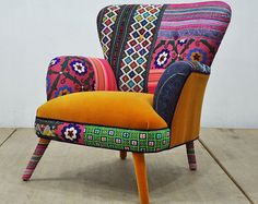 A unique handmade armchair upholstered with vintage Suzani, Thai Hmong and navy blue color velvet fabrics. The design is completed with iron legs oven-drying in pink color. Foam rubber on beech wood frame; iron legs in pink painted. Frame is made of kiln dried hardwood. dimension (cm): 90 cm width x 75 cm height x 80 cm depth ; seat height 45 cm ** Address delivery shipping via air freight by UPS ** Your name, address and phone number are required to complete customs paperwork ** Pieces…