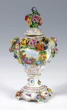 DRESDEN PORCELAIN COVERED URN /VASE: Carl Thieme, Dresden Germany. Hand painted and flower encrusted porcelain with reticulated lid. Measures approx.